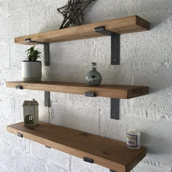 Oak Shelving Fixed to White Wall