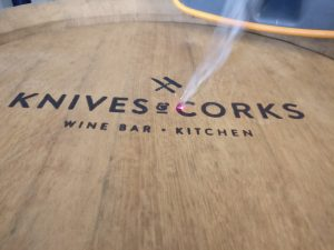 Knives and Corks Wine Bar and Kitchen Logo engraved onto a solid oak wine barrel