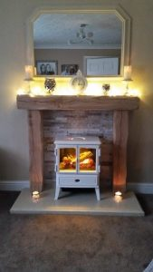 Light Oak Beam Fire Surround above white log burner