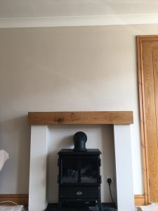 Oak Fireplace Beam above Electric Log Burner
