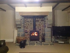 Oak Beam Fitted Above Log Burner in Living Room